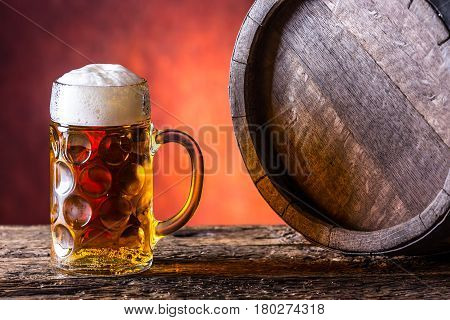 Beer with oak barrel. Draft beer. Draft ale. Golden beer. Golden ale. Two gold beer with froth on top. Draft cold beer in glass jars in home pub hotel or restaurant.