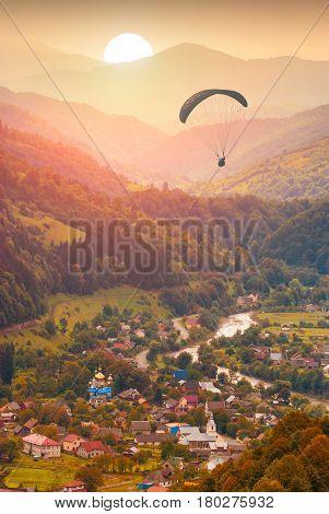 Paraglide Over The Village