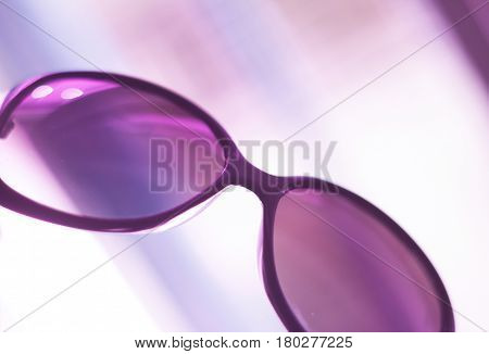 Women's fashion sunglasses. Dark tinted UVA protection glasses used to protect the eyes from the sun.