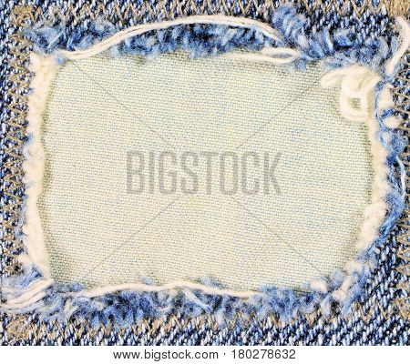 Frayed blue  denim frame. Copy space. Design element.