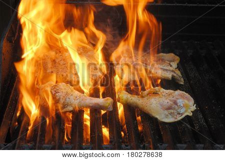 Grilling Flaming Raw Chicken Legs and Thighs