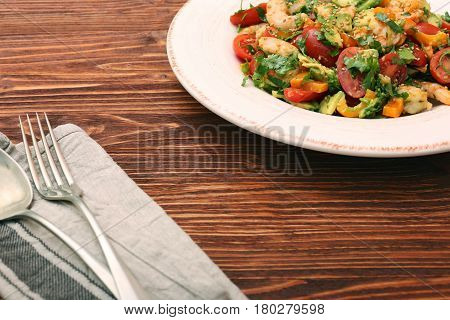 Shrimp and avocado salad with tomato and parsley. Low fat healthy eating concept.