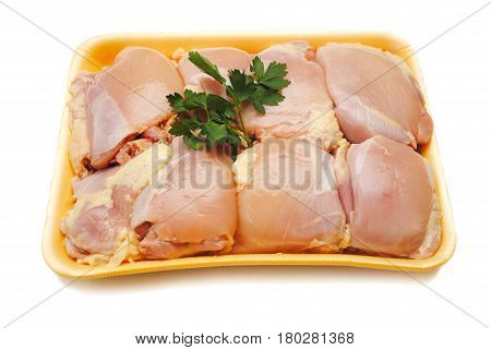 Packaged Raw Boneless Chicken Thighs Garnished with Parsley poster