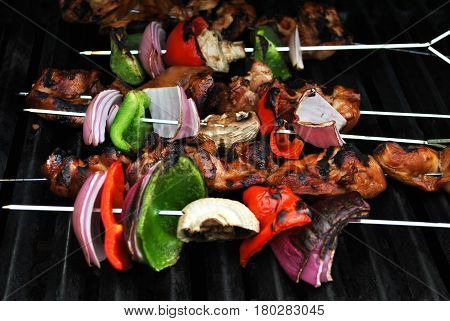 Summer Chicken Kabobs Cooking on a Grill