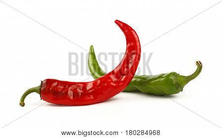 Green And Red Hot Chili Peppers Close Up On White