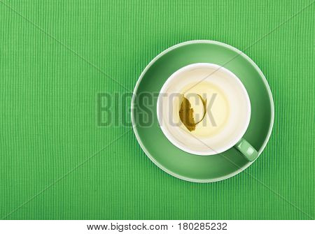 Empty Cup Of Green Tea Close Up Elevated Top View