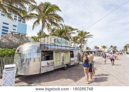 Hollywood Beach Fl USA - March 13 2017: People at the Airstream food truck on Hollywood Beach broadwalk. Florida United States