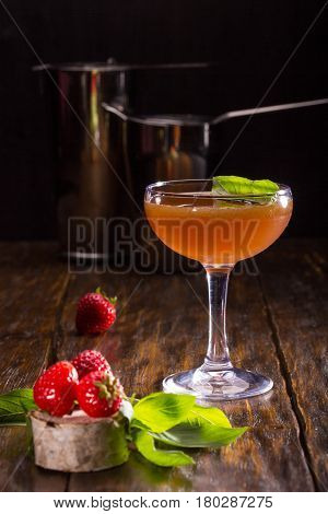 Teenie's cocktail with vodka, strawberry and a basil, with sugar syrup