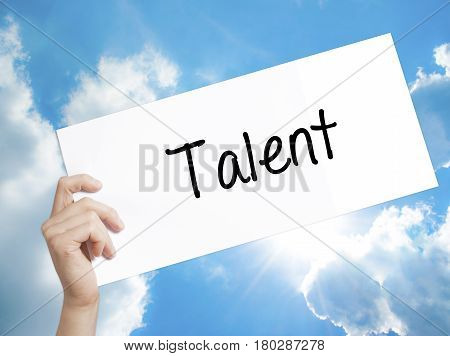 Man Hand Holding Paper With Text Talent  . Sign On White Paper. Isolated On Sky Background