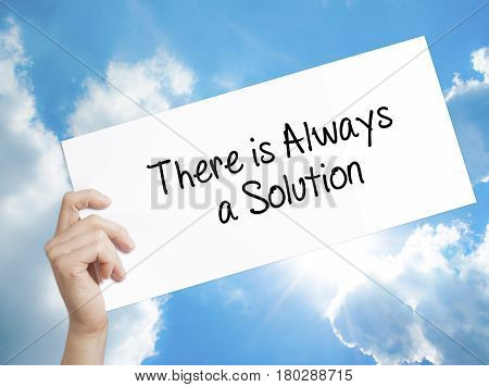 Man Hand Holding Paper With Text There Is Always A Solution . Sign On White Paper. Isolated On Sky B