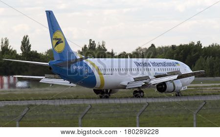 Borispol, Ukraine - May 6, 2014 Ukraine International Airlines Boeing 737-400 aircraft landing on the runway of Borispol International Airport on May 6, 2014. Editorial use only