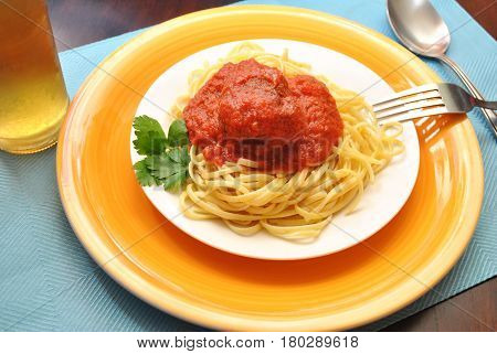 Colorful Plate of Fettuccine with a Whole Meatball