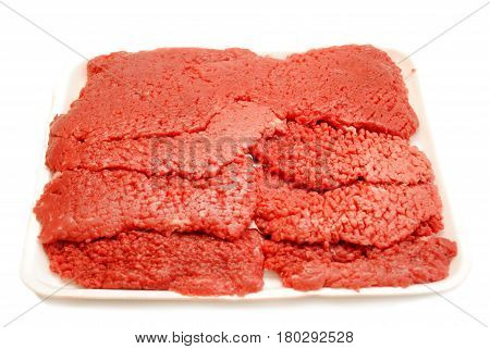Many Raw Cube Steaks Isolated Over White