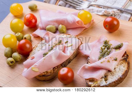 Close Up Of Mortadella Toast With Tomatoes