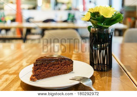 Delicious soft and moist Chocolate Cake on plate