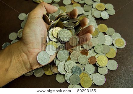Saving money coins. Coins of Thailand background.