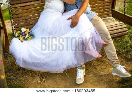 Lovely groom and wife on a rocking chair no face