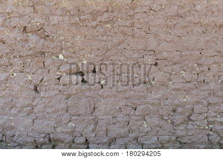 Old rough pitted stone wall Williams Arizona