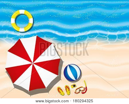 Tropical beach and umbrella with accessories on the sand.