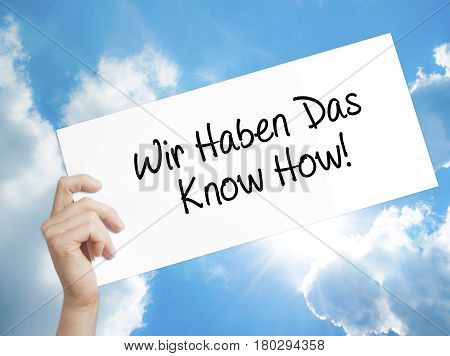 Man Hand Holding Paper With Text Wir Haben Das Know How! (we Have The Know-how In German)  . Sign On