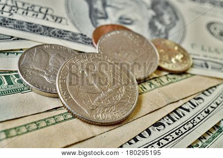 Set of silver Quarter Dollar coins (currency in the USA, USD) on the background made of green bank notes