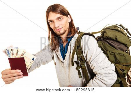 Man tourist backpacker holding passport full of money. Young guy hiker backpacking. Summer vacation travel. Isolated on white background.