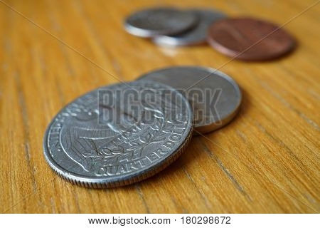 Set of silver Quarter Dollar coins (currency in the USA, American Dollar, USD) on the wooden background