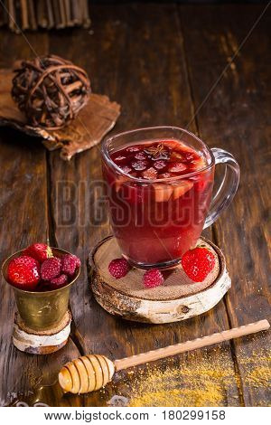 A hot berry grog with spices, berries, tea and dark rum
