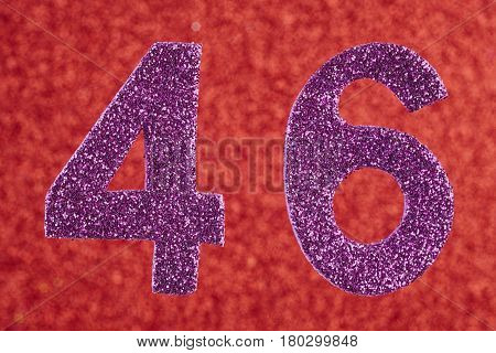 Number forty-six purple color over a red background. Anniversary. Horizontal