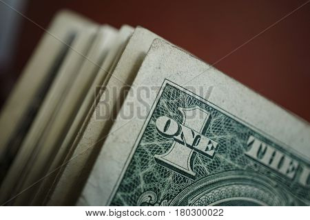 Macro detail of a one dollar bank note in a row with many other bank notes