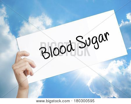 Man Hand Holding Paper With Text Blood Sugar . Sign On White Paper. Isolated On Sky Background