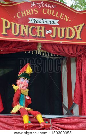 Colchester United Kingdom -1 April 2017: Traditional Punch and Judy booth with Mr Punch sitting down