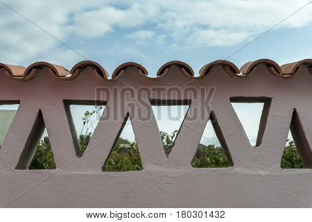 Adobe Wall With Triangles And Tiles