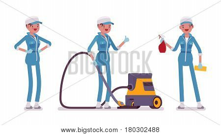 Set of female professional busy janitor in standing pose, young and smiling, wearing blue overall, protective gloves, holding vacuum cleaner, spray bottle, full length, isolated on white background