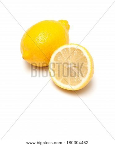 Two lemons isolated on a white background