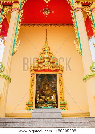 buddha statue view through the door of temple. Generality in Thailand any kind of art decorated in Buddhist church temple pavilion temple hall monk's house etc. created with money donated by people to hire artist. They are public domain or treasure of Bud
