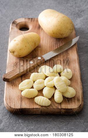 Raw gnocchi on gray stone background.Italian food