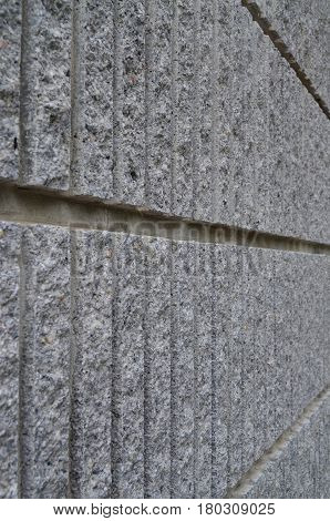 Side view of gray coarse cement wall texture