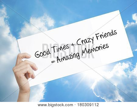 Man Hand Holding Paper With Text Good Times + Crazy Friends = Amazing Memories . Sign On White Paper