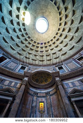 ROME - OCTOBER 2, 2012: Inside the Pantheon: the famous dome with the oculus. Pantheon is a famous monument of ancient Roman culture, the temple of all the gods built in the 2nd century.