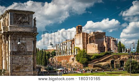 Ruins of the Temple of Venus at the Roman Forum in Rome, Italy. Arch of Trajan on the left. Piazza del Colosseo.