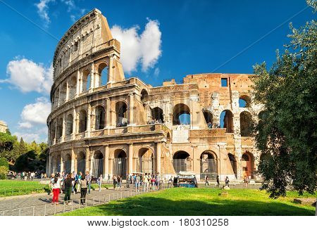 ROME - OCTOBER 4, 2012: Tourists visiting the Colosseum (Coliseum). The Colosseum is a major tourist attraction in Rome.