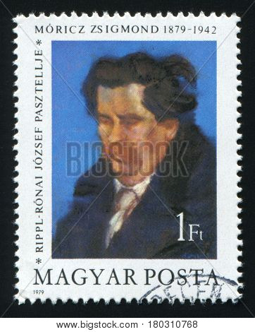 HUNGARY - CIRCA 1979: A post stamp printed in Hungary shows a painting of writer Zsigmond Moricz by Jozsef Ripple-Ronai, circa 1979