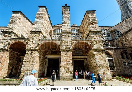 ISTANBUL - MAY 26, 2013: Tourists visit the Hagia Sophia (Ayasofya). Church of Hagia Sophia is the greatest monument of Byzantine Culture and tourist attraction.