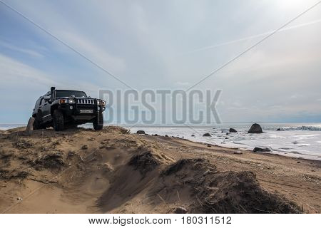 Leningrad region, Russia - April 01, 2017. Hummer H3 on the beach of the Gulf of Finland in the Leningrad region. Hummer H3 is a compact SUV produced by GM