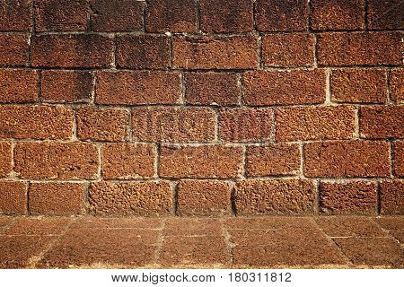 orange rough brick wall texture, solid brickwork pattern as block backdrop