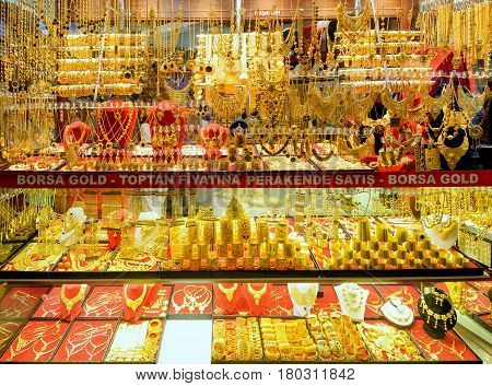 ISTANBUL - MAY 27, 2013: Oriental gold jewelry sold in the Grand Bazaar. The Grand Bazaar is the oldest and the largest covered market in the world with 61 covered streets.