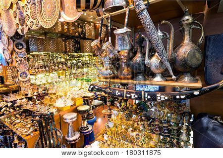 ISTANBUL - MAY 27, 2013: A variety of oriental items offered for sale at the Grand Bazaar in Istanbul, Turkey. The Grand Bazaar is the oldest and the largest covered market in the world.