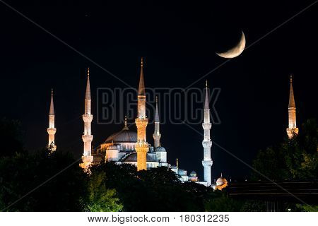 View of the Blue Mosque (Sultanahmet Camii) at night with Crescent, Istanbul, Turkey