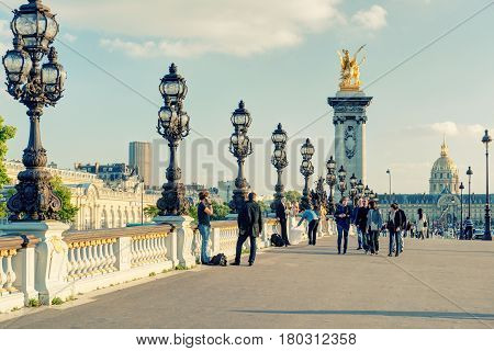 PARIS - SEPTEMBER 20, 2013: View of Alexandre III bridge in Paris. Alexandre III bridge is one of the top tourist destinations in Paris.